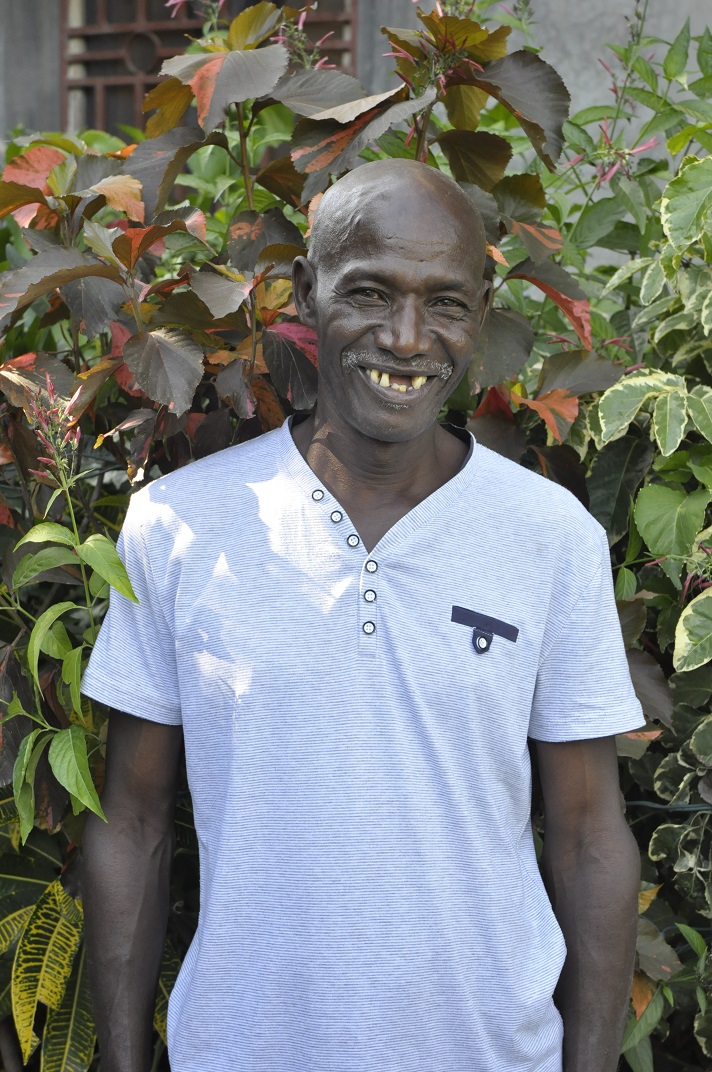 Haitian man poses with beautiful smile