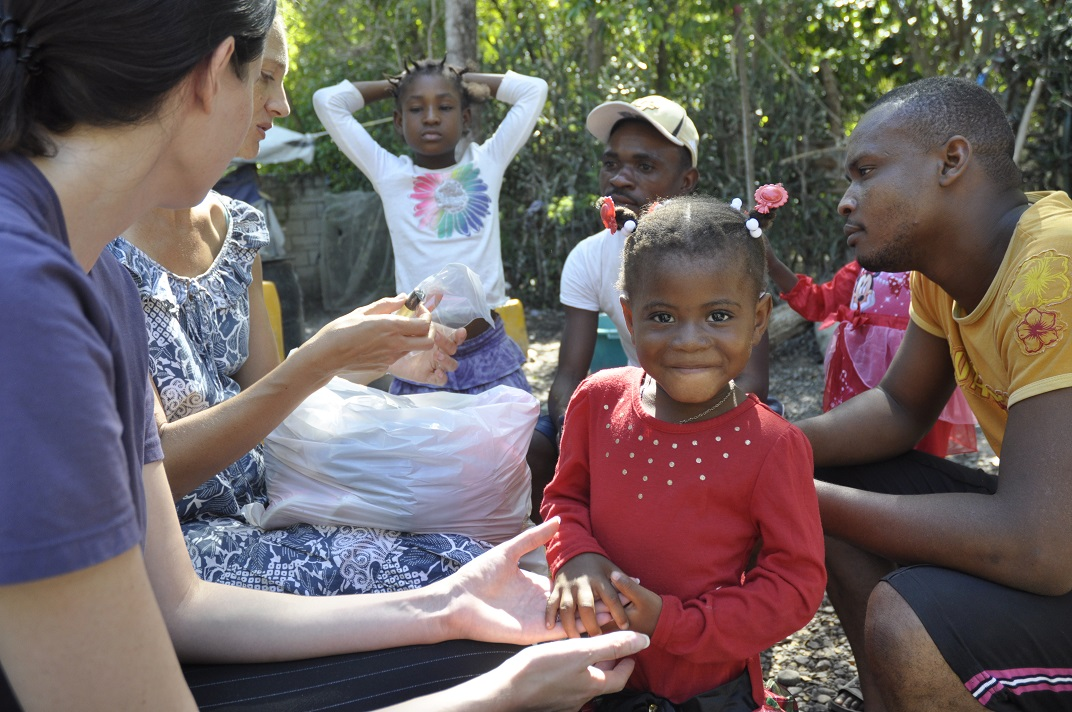 Haitian missionaries meet with families