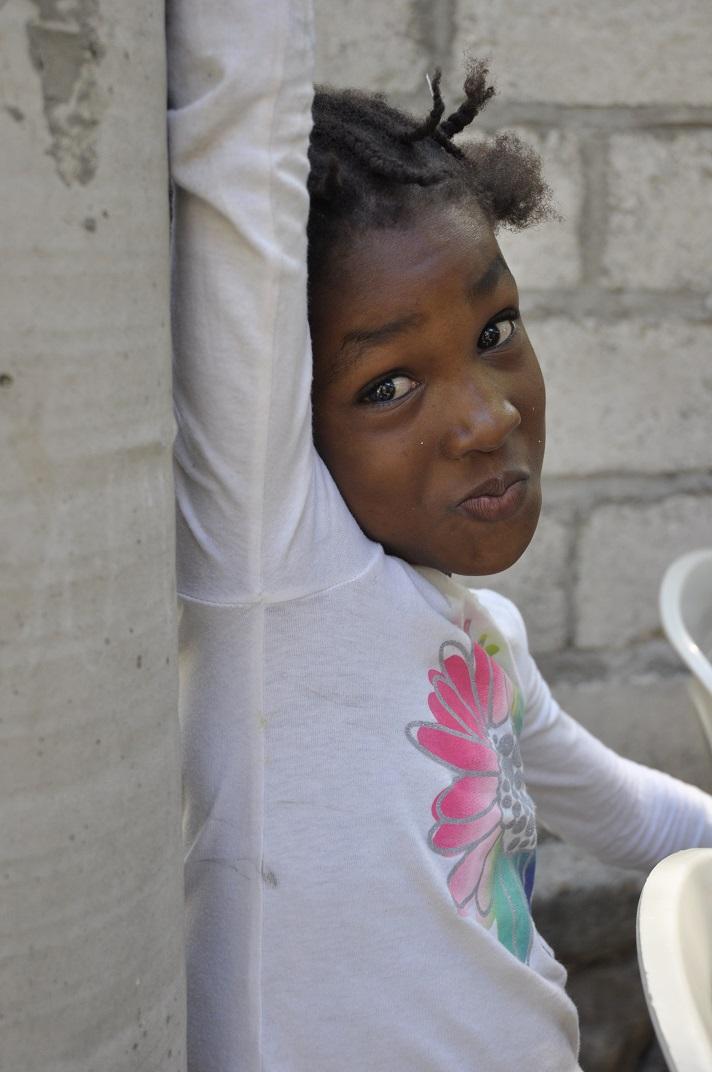 Little girl in Haiti poses for photo