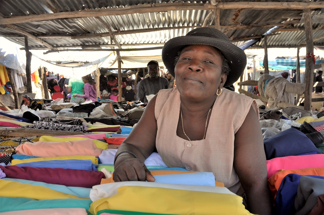 Haitian women at market selling textile fabrics