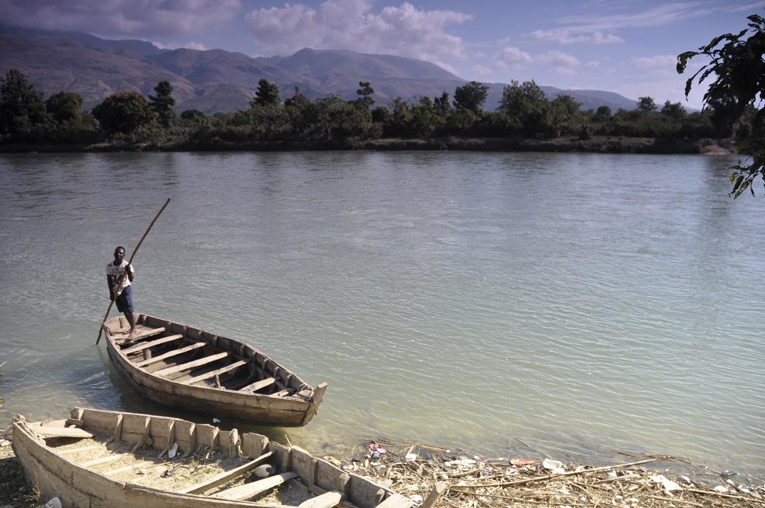 Haitian ferry man waiting for people before crossing Artibonite river