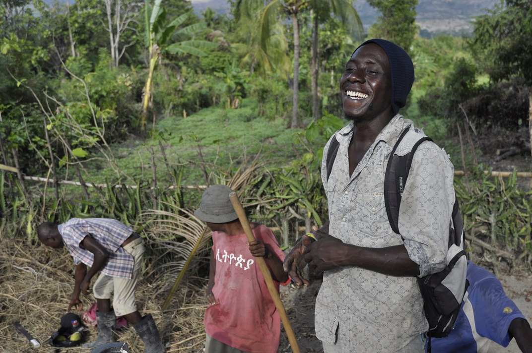 Haitian men after day of working on the farm