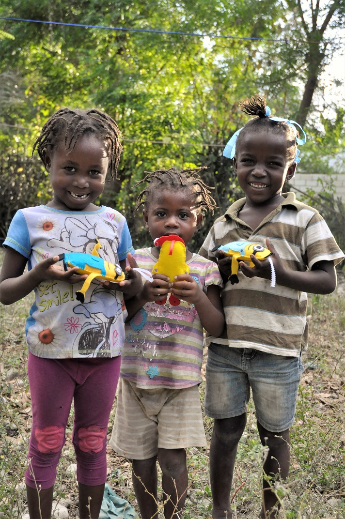 Haitian children play with toys