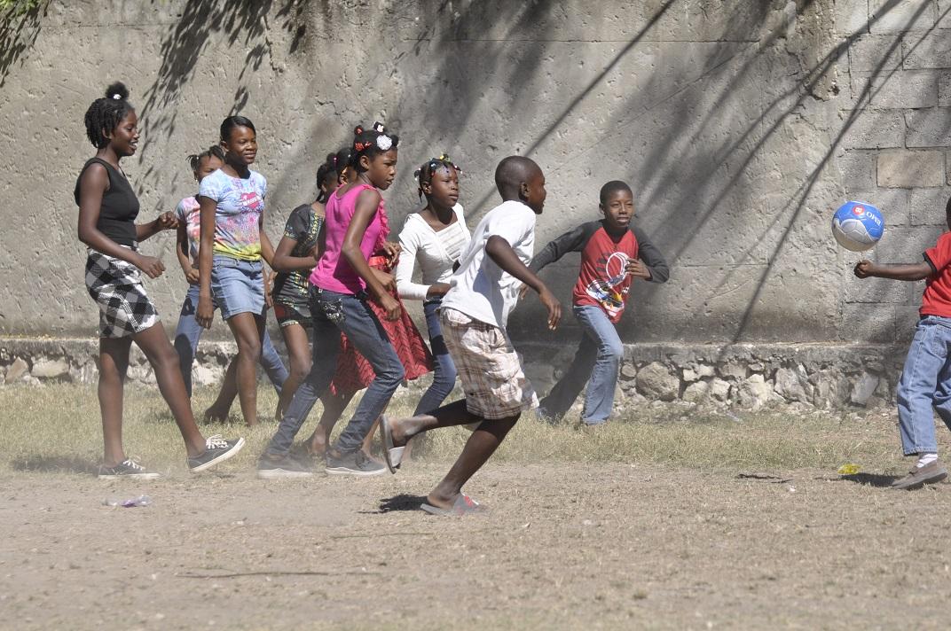 Haitian school children play soccer
