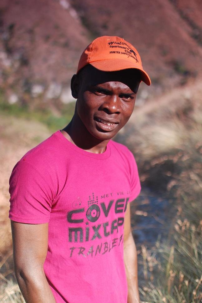 Haiti man poses for photographer